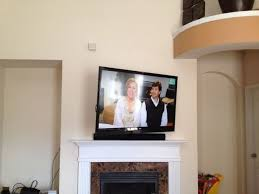 17 best ideas about tv wall mount installation on flat screen tv mounted over fireplace