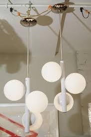a clean lined pendant chandelier by kaiser leuchten with three opaline glass globes newly