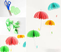 these paper umbrellas are so simple to make and they look adorable hang them in
