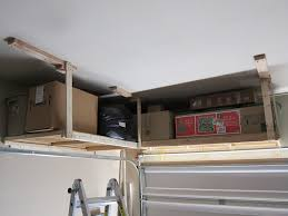 simple diy custom wood mounted garage ceiling storage shelves for small garage spaces and white ceiling ideas
