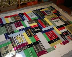 How to Make an Out-of-the-Ordinary T-Shirt Quilt: Part Two ... & Quilt sandwich! Lay out your backing fabric wrong side up, quilt batting,  and quilt top. Your backing and batting should be larger than your quilt  front. Adamdwight.com