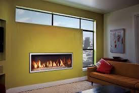 simple yet sophisticated a fullview décor fireplace with antique copper wide grace front and birch fire base brings modern efficiency to a mid century