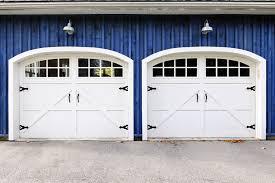 garage door opening styles. Striking White Carriage Style Garage Doors On Blue Home. Door Opening Styles