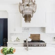 alyssa rosenheck brown beaded chandelier over gray center island
