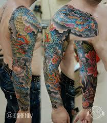 тату рукав в японском стиле с драконом и цветами фото татуировок