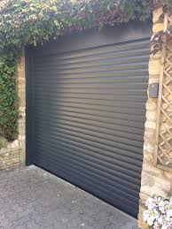 stylish black roller garage door from hormann horizontally ribbed providing the perfect combination of modern style and space