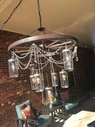 wagon wheel chandelier for on large wagon wheel chandelier with 3 tiers of mason