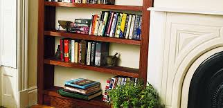 a built in bookcase by a fireplace