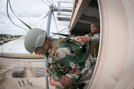 u s department of defense photo essay an n army paratrooper jumps from a 34 foot parachute training tower help from