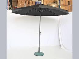 black outdoor umbrella event planner in dubai event planner in dubai