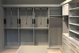 pull down closet rods to help reach clothes in tall closets