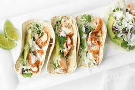 easy fish tacos with lime crema when lime and cilantro e together with fish