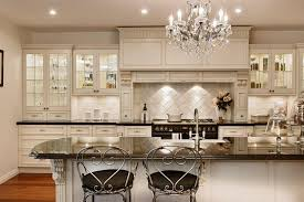 home stunning wooden kitchen cabinet and wall combined with exotics crystal chandelier hang and wooden floor in the futuristic kitchen as well bar stools