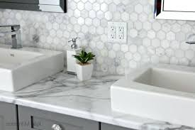 wilsonart calcutta marble laminate countertop with hexagon accent tile and gray painted cabinet by kylie m