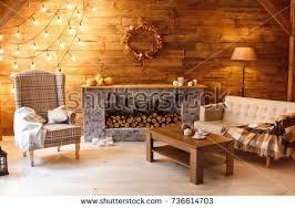 Home fort Armchair Near Fireplace Firewood Stock