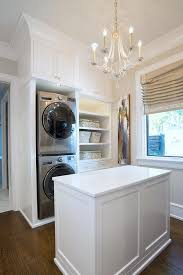 large walk in closet with stacked enclosed washer and dryer