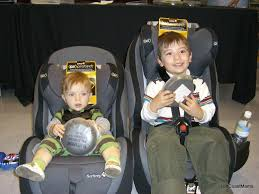 aidan and quinlan in the seats side by side