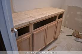 diy butcherblock countertop cut to size and in place on bathroom vanity