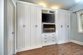 ... Wall unit,Fireplace,custom cabinets,armoire