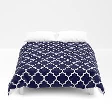 white moroccan quatrefoil on navy blue duvet cover