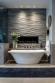 tile ideas install tiles to add texture to your bathroom wavy tiles behind the bathtub and surrounding the built in fireplace create a feature wall
