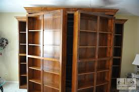murphy bed with shelves. Modren Shelves Swingingbookcasesrevealmurphybed Bookcases Swing Open Effortlessly To  Reveal Murphy Bed On Bed With Shelves R