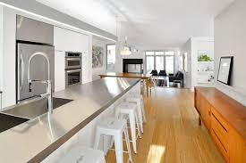 View in gallery Wooden accents in a white kitchen with stainless steel  cabinets