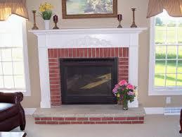 white mantel and trim around brick fireplace