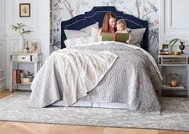 bedroom furniture find a woman and child reading book on bed