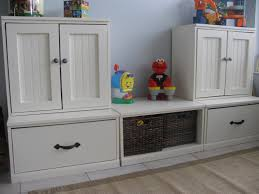 storage idea with white cupboards completed with kids toys image login sign up to