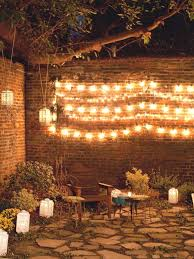 string lights and lanterns illuminate garden