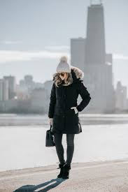 jessica sy shares tips for surviving winter in chicago wearing a pom beanie canada