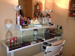 saving small spaces dressing room organization with makeup storage under glass top vanity table and wall mounted mirror with perfume shelves ideas