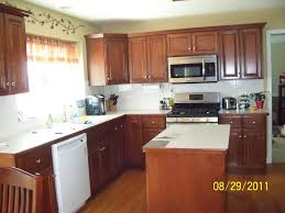 Small Picture Brilliant Maple Kitchen Cabinets With Black Appliances And