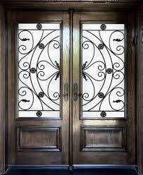 exceptional fiberglass entry door with wrought iron scroll