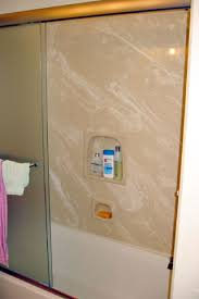 shower after renovations using sierra caramel tere stone tub wall and easco shower doors