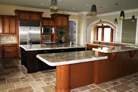 furniture brown wood kitchen island table with granite top on brown tile floor added by