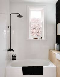 black bathroom fixtures. (Image Credit: Terrence Chin For Share Design) Black Bathroom Fixtures Apartment Therapy
