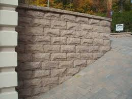 sloped driveway with custom retaining