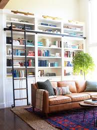 designer jenny komenda s living room where a red and blue statement rug inspired the rest