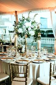 round table centerpiece decor tall centerpieces for the tables at this tented water fall wedding ideas table decorations round