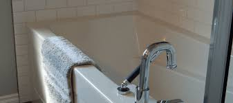 grout or caulk around tub