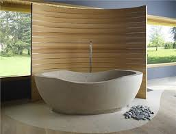 spa inspired bathroom with natural stone bathtub