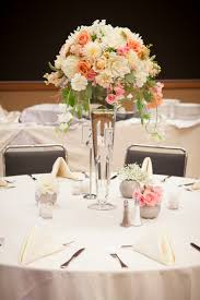 sweet wedding centerpieces decoration featuring glass long vase flower arrangement with white roses