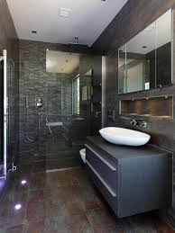 Trendy corner shower photo in London with a vessel sink, flat-panel  cabinets,