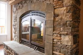 image of indoor outdoor wood fireplace see thru fireplaces acucraft pertaining to indoor outdoor fireplace
