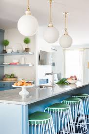 globe pendants over island. Wonderful Pendants Blue Kitchen With Green Accents And Globe Pendants Over Island E