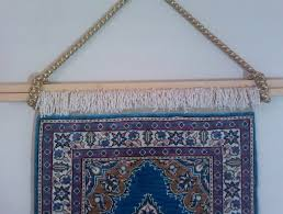 how to hang a rug on the wall without damaging it