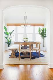 layering rugs cowhide over seagrass rumi neely apt photo by tessa neustadt via homepolish