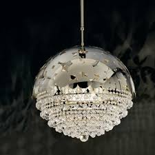 featuring an upper dome realised in laser cut steel with a pattern formed of varied sized circular discs from which ds of clear crystal beads are